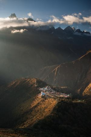 A bird's-eye view of Tengboche monastery, surrounded by mountains. by Martin Edstrom