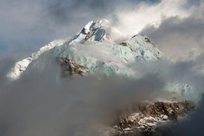 A mountain shrouded in clouds. by Martin Edstrom