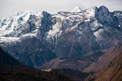 A snow-capped Himalayan mountain range dwarfs the small village of Tengboche. by Martin Edstrom