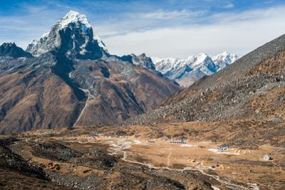 A view of Ama Dablam basecamp from up high. by Martin Edstrom