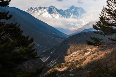 The summits of Everest, Lhotse, Nuptse and Changtse in the distance. by Martin Edstrom