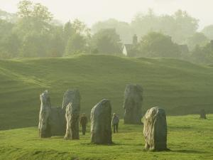 People Walk Among the Stones of Avebury Circle by Martin Gray