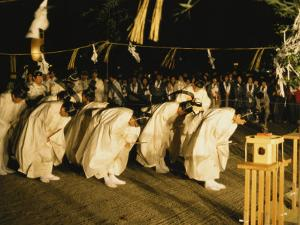 Shinto Priests Bow at the Kamiarizuku Festival by Martin Gray