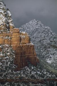 Snow-covered red rock formations in Sedona. by Martin Gray