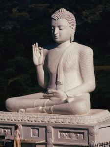 Visitor Prays at the Mihintale Buddha Statue by Martin Gray