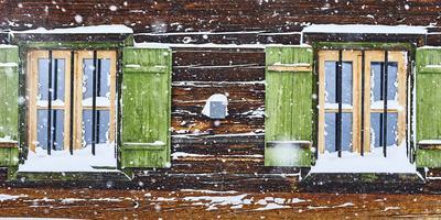 hut window with shutters, snowdrift, detail