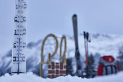 large thermometer in the snow, frost, cold, slide, skis, backpack, mountains, blur,