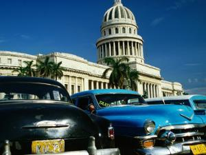 Classic American Taxi Cars Parked in Front of National Capital Building, Havana, Cuba by Martin Llad?