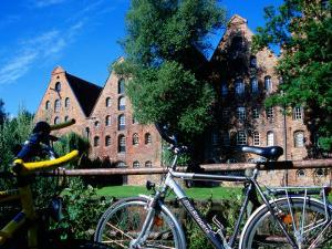 Bicycles in Front of Salzspeicher, Lubeck, Schleswig-Holstein, Germany by Martin Lladó