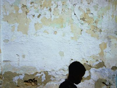 Boy Passing by Wall, Tozeur, Tunisia