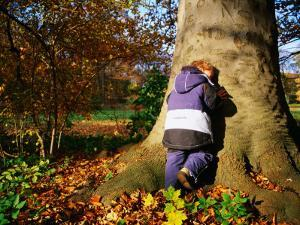 Boy Playing Hide-And-Seek in Frederiksberg, Copenhagen, Denmark by Martin Lladó