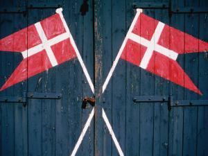 Danish Flags Painted on Doors of Life-Saving Station, Sonderho, Denmark by Martin Lladó