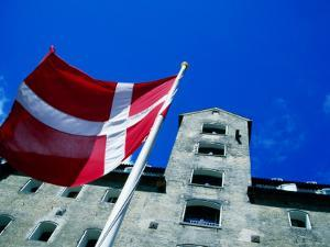 Dannebrog, The Danish Flag, In Front of Admiral Hotel, Copenhagen, Denmark by Martin Lladó