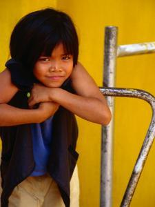 Portrait of Lao Girl at Entrance to Wat St. Muang, Vientiane, Vientiane Prefecture, Laos by Martin Lladó