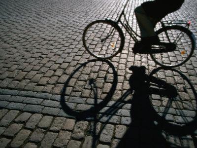 Shade of Cyclist Crossing Amalienborg Slotsplads, Copenhagen, Denmark