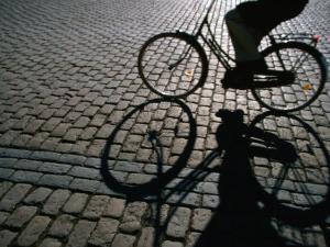 Shade of Cyclist Crossing Amalienborg Slotsplads, Copenhagen, Denmark by Martin Lladó