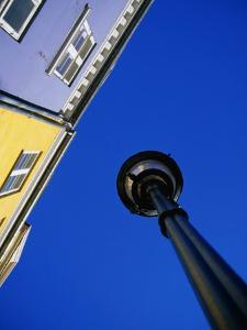 Street Lamp and Houses at Nyhavn, Copenhagen, Denmark by Martin Lladó