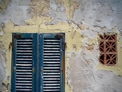 Weathered House with Shutters at Bastoni Marco Polo, Alghero, Sardinia, Italy