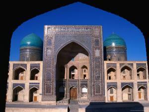 Entrance to Mir-I-Arab Medressa, Uzbekistan by Martin Moos