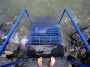 Feet Entering the Thermal Waters of Lake Balaton, Keszthely, Hungary by Martin Moos