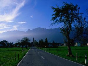 Ruggell village and Swiss mountains, Ruggell, Liechtenstein by Martin Moos