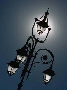 Sunlight Behind Lamp Post, Casale Monferrato, Italy by Martin Moos