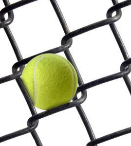 Tennis Ball in Fence by Martin Paul