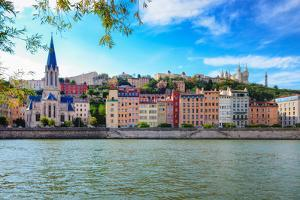 Lyon Cityscape from Saone River with Colorful Houses and River by MartinM303