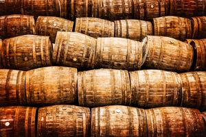 Stacked Pile of Old Vintage Whisky and Wine Wooden Barrels by MartinM303