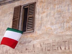 Italian Flag Hanging from Window by Martyn Goddard