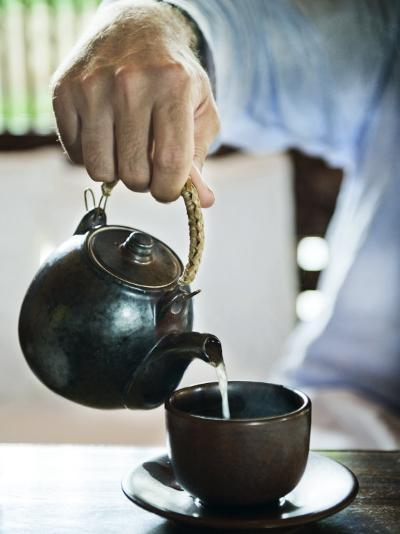 Masculine Hand Pouring Tea into a Cup-xPacifica-Photographic Print