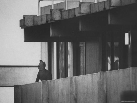 Masked Black September Arab Terrorist Looking from Balcony of Athletes Housing Complex-Co Rentmeester-Photographic Print