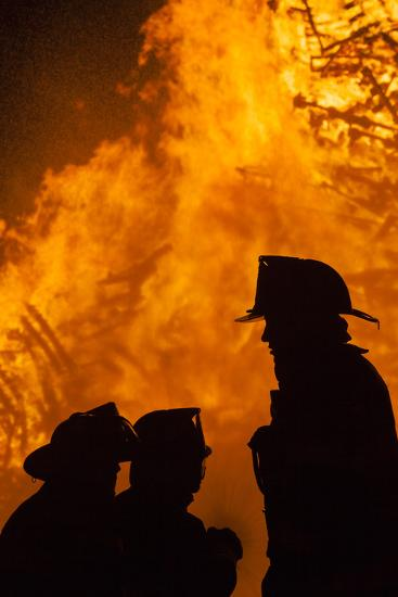 Massachusetts, Cape Ann, Fourth of July Bonfire, Silhouette of Firemen-Walter Bibikow-Photographic Print