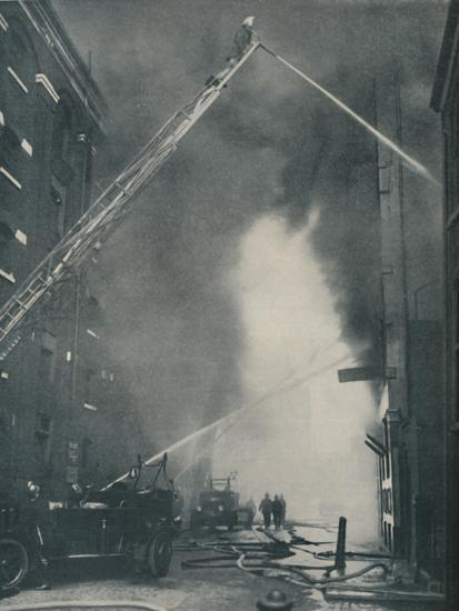 'Massed Forces of the Modern Fire-Fighter Pitted Against a City Blaze', c1935-Unknown-Photographic Print