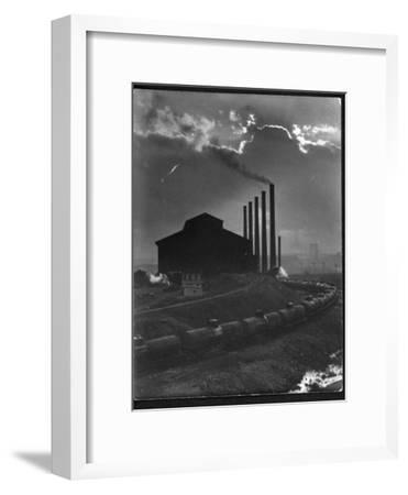 Massive Otis Steel Mill Surrounded by Tanker Cars on Railroad Track on a Cloudy Day-Margaret Bourke-White-Framed Premium Photographic Print