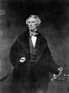 Samuel Morse and his recorder, 1857 by Mathew Brady