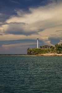 Light House On Islet by Matias Jason