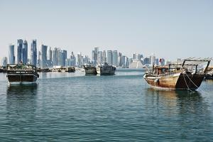 Downtown Doha with its Impressive Skyline of Skyscrapers and Authentic Dhows in the Bay by Matt