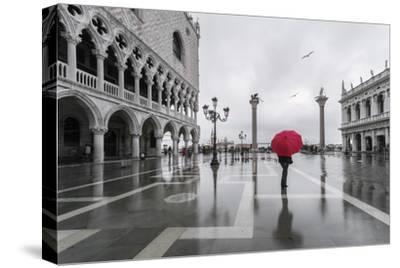 Italy, Veneto, Venice. Woman with Red Umbrella in Front of Doges Palace with Acqua Alta (Mr)
