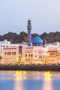 Oman, Muscat. Mutrah Harbour and Old Town at Dusk by Matteo Colombo