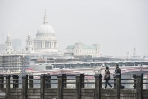 Couple on a Pier Overlooking St. Paul's Cathedral on the Banks of the River Thames, London, England by Matthew Williams-Ellis