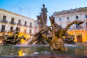 Fountain of Artemis in Archimedes Square (Piazza Archimede) at Night by Matthew Williams-Ellis