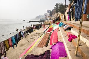 Washing drying on ghats next to the River Ganges, Varanasi, Uttar Pradesh, India, Asia by Matthew Williams-Ellis