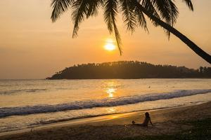 Woman Sitting on Mirissa Beach Watching the Sun Set by Matthew Williams-Ellis