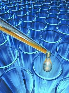 Pipette Dripping Liquid into Test Tubes by Matthias Kulka