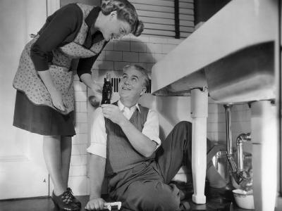 Mature Couple Fixing Kitchen Plumbing-George Marks-Photographic Print