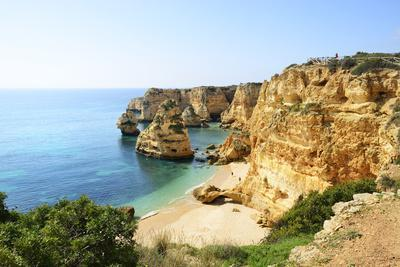 The coastal rock formations at Marinha beach (Praia da Marinha). Algarve, Portugal