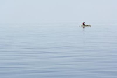 A Bajau Sea Gypsy Fisherman in Waters Off Mabul Island, Sabah, Malaysia by Mauricio Handler