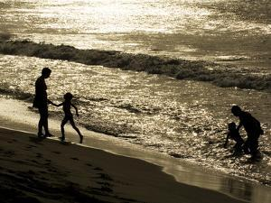 A Family Plays on Grande Riviere Beach at Sunset by Mauricio Handler
