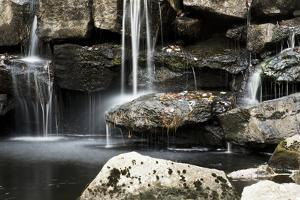 A Small Waterfall Cascades over Rocks at Runaround Pond by Mauricio Handler